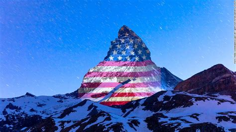 Matterhorn in Swiss Alps lit up with American flag