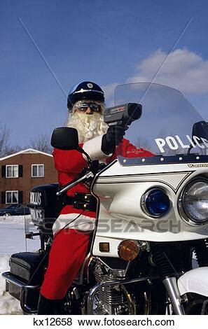 Police Officer Dressed Up As Santa On Motorcycle Stock
